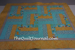 baby quilt showing curved triangle marking for free motion ruler work