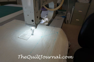 a picture of a quilt sandwich with markings showing where your stitch pattern should start and stop with free motion quilting ruler work