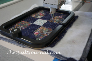 a picture of the new martelli free motion quilting grippering on a quilt block showing plenty of room to FMQ block
