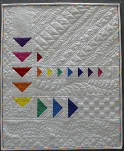 a picture of a Beautiful Modern Quilt using free motion quilting and ruler work by Brenda Roach
