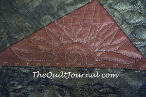a free motion quilted sun burst
