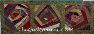 A picture of a crazy quilt with free motion quilting in all the irregular areas