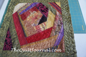 picture of free motion quilting on a crazy quilt with crazy fabrics