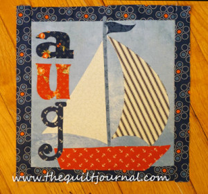 a picture of August block of the month wall hanging applique from the book Count on it by Nancy Halvorsen