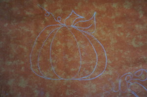 a picture of a pumpkin stencil marked with Stencil Magic