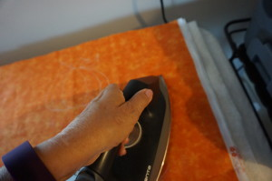 a picture showing ironing away Stencil Magic markings