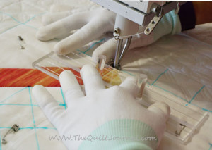a pictrue of using a quilt template to outline stitch around quilt