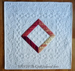 a picture of my version of Judi Madsen's AQS iquilt class traditional quilt