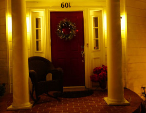 A picture of my front door with a Christmas wreath