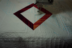 A picture if a 3/4 finished modern quilt