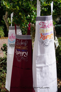 "a picture if 3 aprons with Urban threads ""spice it up designs embroidered on themthat I am going to give a Christmas gifts"