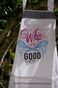 a Christmas Gift apron showing and embroidered design from Urban threads