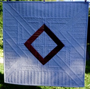 a picture of myModern free motion quilted quilt from Judi Madsen's class