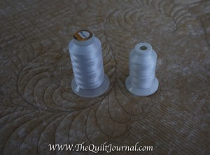 a picture of Wonderfil Invisafil next to a large spool of silk thread