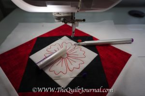 A picture showing the embroidery design and how I mark where I started stitching with an air-soluable pen