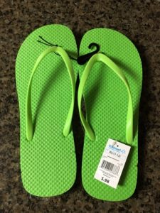 A picture of flops flops from walmart with a price tag of 98 cents in bright green that will make several hundred Pinmoor DIY alternative pin covers
