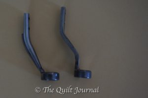 a picture comparing the old APQS ruler foot to the new one